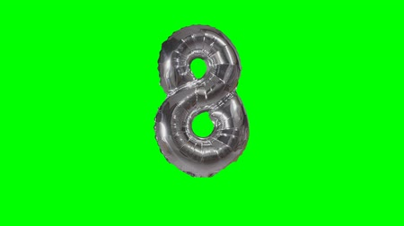 eight : Number 8 eight years birthday anniversary silver balloon floating on green screen Stock Footage