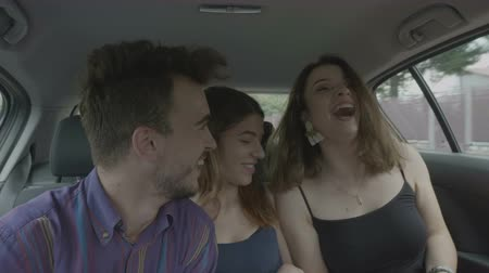 quando : Cheerful students having fun when they travel in the car taking selfie pics and video streaming with digital phone cheering and dancing together Filmati Stock