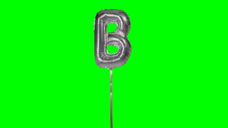 книгопечатание : Letter B from alphabet helium silver balloon floating on green screen