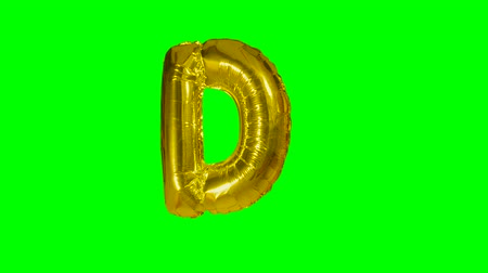 szél : Big Letter D from alphabet helium gold balloon floating on green screen