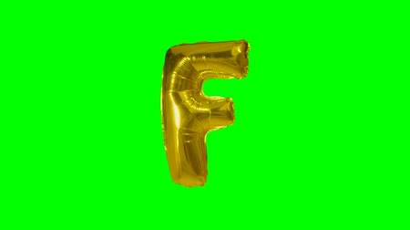 letter f : Big Letter F from alphabet helium gold balloon floating on green screen