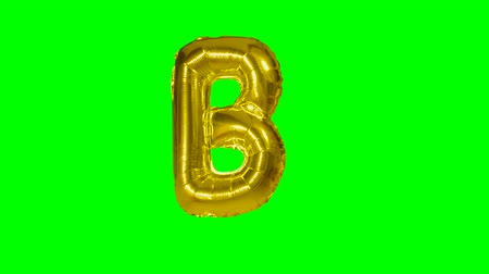 word balloon : Big Letter B from alphabet helium gold balloon floating on green screen
