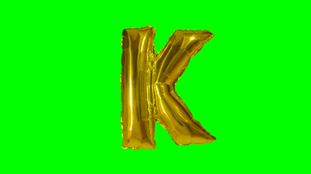 bab : Big Letter K from alphabet helium gold balloon floating on green screen