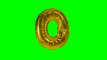 conversa : Big Letter O from alphabet helium gold balloon floating on green screen