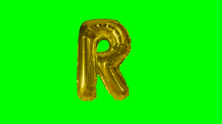sto : Big Letter R from alphabet helium gold balloon floating on green screen