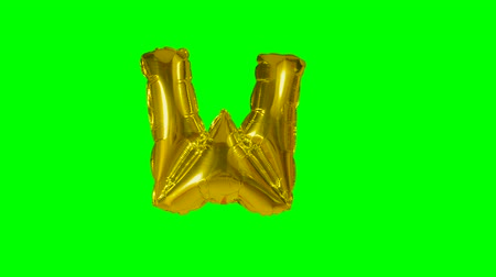 letter w : Big Letter W from alphabet helium gold balloon floating on green screen Stock Footage