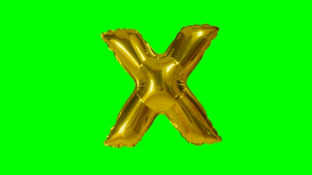 word balloon : Big Letter X from alphabet helium gold balloon floating on green screen