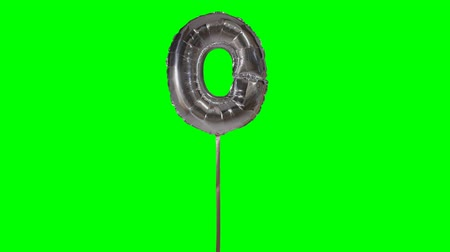 conversa : Letter O from alphabet helium silver balloon floating on green screen