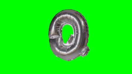 word balloon : Big Letter Q from alphabet helium silver balloon floating on green screen Stock Footage