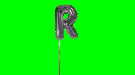 sto : Letter R from alphabet helium silver balloon floating on green screen Dostupné videozáznamy