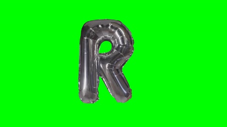 sto : Big Letter R from alphabet helium silver balloon floating on green screen