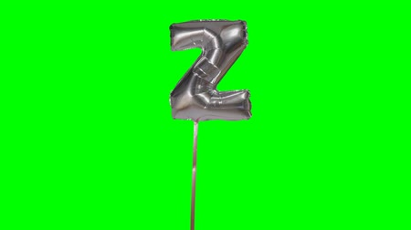 nafukovací : Letter Z from alphabet helium silver balloon floating on green screen Dostupné videozáznamy