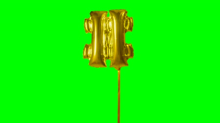 pound : Sign symbol number hash pound and from alphabet helium gold balloon floating on green screen