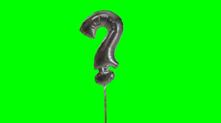 kihallgatás : Sign symbol question mark from alphabet helium silver balloon floating on green screen Stock mozgókép