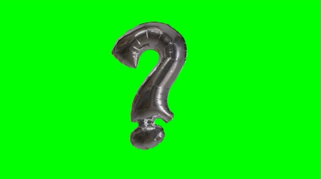 interrogation : Big Sign symbol question mark from alphabet helium silver balloon floating on green screen Stock Footage