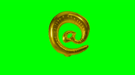 книгопечатание : Big Sign symbol at from alphabet helium gold balloon floating on green screen Стоковые видеозаписи