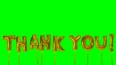 sayesinde : Word thank you from helium golden balloon letters floating on green screen