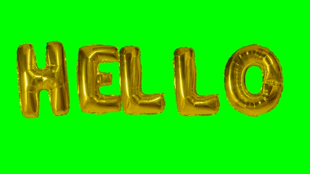 word balloon : Word hello from helium gold balloon letters floating on green screen