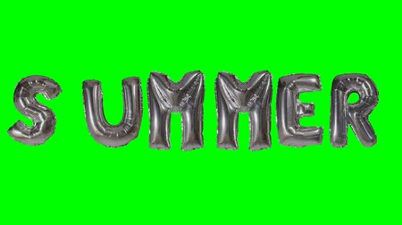 word balloon : Word summer from helium silver balloon letters floating on green screen Stock Footage