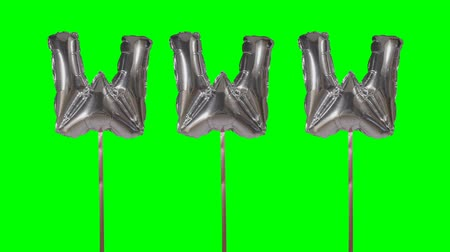 url : Word www web internet from helium silver balloon letters floating on green screen