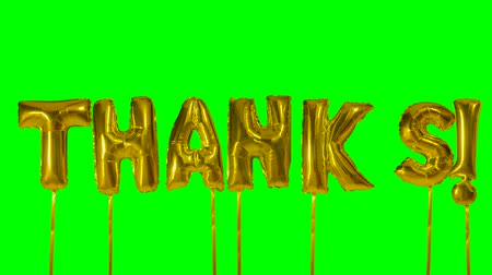 díky : Word thanks from helium golden balloon letters floating on green screen