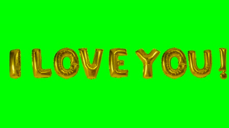 klíčové slovo : Word I love you from helium gold balloon letters floating on green screen Dostupné videozáznamy