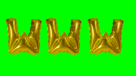 domein : Word www web internet from helium gold balloon letters floating on green screen
