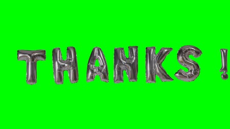 florete : Word thanks from helium silver balloon letters floating on green screen