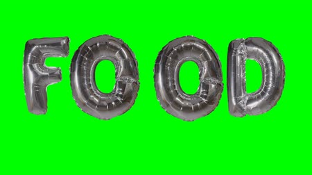 word balloon : Word food from helium silver balloon letters floating on green screen Stock Footage