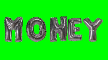 klíčové slovo : Word money from helium silver balloon letters floating on green screen Dostupné videozáznamy