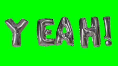 evet : Word yeah from helium silver balloon letters floating on green screen