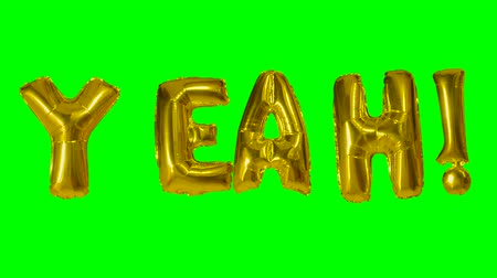 evet : Word yeah from helium gold balloon letters floating on green screen Stok Video