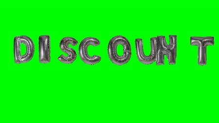 販売のための : Word discount from helium silver balloon letters floating on green screen