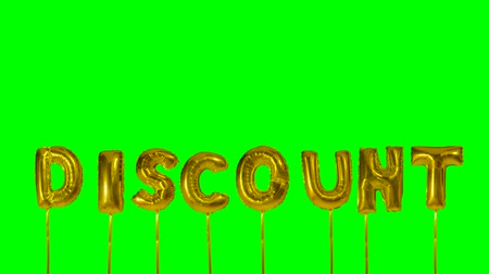 folyo : Word discount from helium golden balloon letters floating on green screen Stok Video