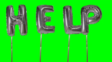 perguntando : Word help from helium silver balloon letters floating on green screen