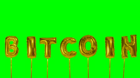 fintech : Word Bitcoin from gold helium balloon letters floating on green screen Stock Footage
