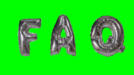 soletrar : Word faq from helium silver balloon letters floating on green screen