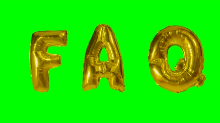 почему : Word faq from helium gold balloon letters floating on green screen