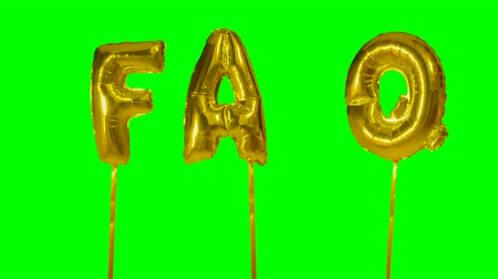 почему : Word faq from helium golden balloon letters floating on green screen