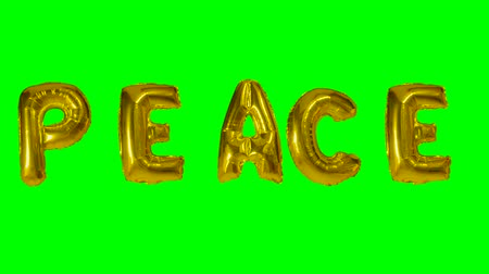 folyo : Word peace from helium gold balloon letters floating on green screen Stok Video