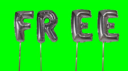 soletrar : Word free from helium silver balloon letters floating on green screen