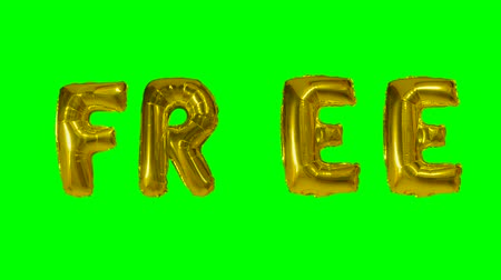 soletrar : Word free from helium gold balloon letters floating on green screen