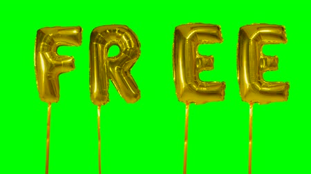 democrático : Word free from helium golden balloon letters floating on green screen