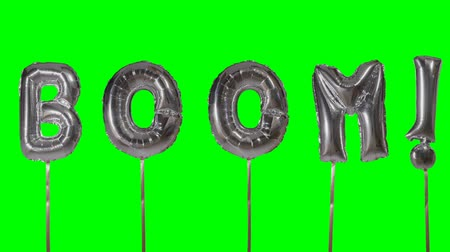 řev : Word boom from helium silver balloon letters floating on green screen
