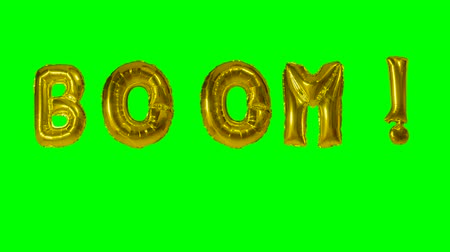 havlama : Word boom from helium gold balloon letters floating on green screen Stok Video