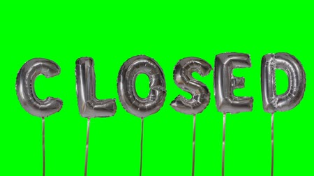 kapalı : Word closed from helium silver balloon letters floating on green screen