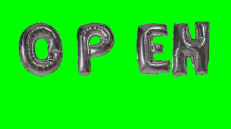 kapalı : Word open from helium silver balloon letters floating on green screen Stok Video