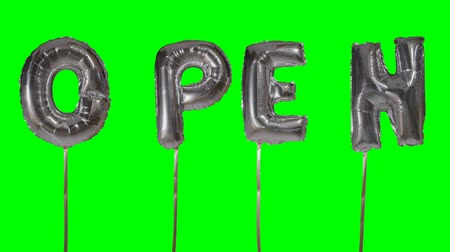 word balloon : Word open from helium silver balloon letters floating on green screen Stock Footage