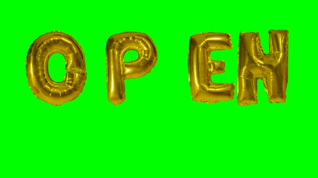 kapalı : Word open from helium gold balloon letters floating on green screen Stok Video