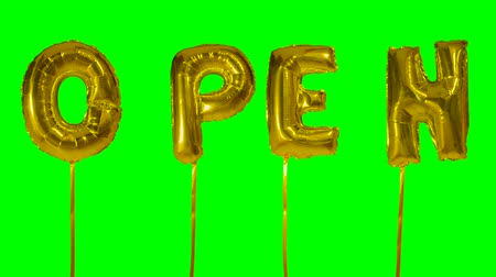 kapalı : Word open from helium golden balloon letters floating on green screen
